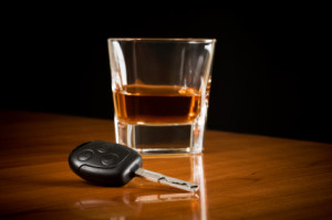 Image Of Glass Of Alcohol With Key For DUI/Criminal Defense Lawyer - NOLA Criminal Law